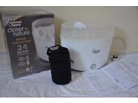 Electric sterilizer with and insulating milk bottle bag