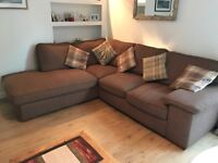 Corner sofa with chaise lounge in brown