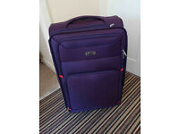 Purple medium size roller suitcase, luggage. Used once.