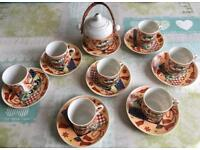 7 Oriental small coffee/tea cups seat with sugar holder