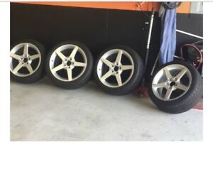 4 rims and tires from 2005 corvette