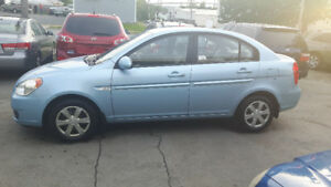 Great little cat,  2007 Hyundai Accent? Cheap $$$$
