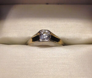 .51 ct diamond solitaire 14 kt white and yellow gold