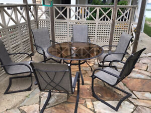 Glass Outdoor Dining Table with (6) Chairs c/w (2) foot ottoman.