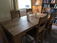 Solid cherry wood table and 6 oak chairs