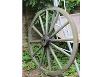 Large Vintage Wooden Cart Wheel with Metal banding on outside