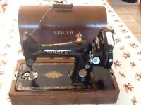Singer sewing machine with case.
