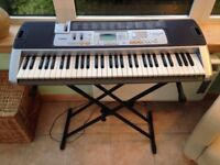 CASIO LK-110 - Key Lighting Keyboard With MIDI. Includes Box, Stand, Instructions, Music Book.