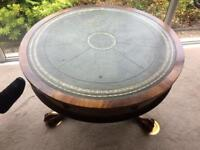 Drum table inlaid with dark green leather