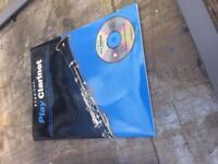 Play clarinet instruction book with cd opened but not used
