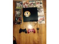 Black Sony ps3 with games