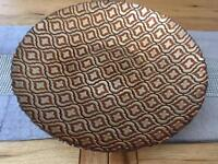 Amber coloured glass charger plate