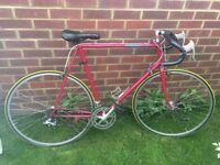 Large red racing bicycle