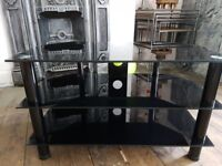 Black glass tv stand in perfect condition