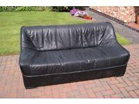 Black IKEA sofa - 3 seater, leather-look-and-feel.