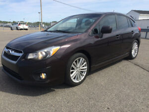 2012 Subaru Impreza Turning Hatchback