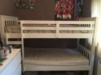 Wite wood bunk bed heavy duty, can be separated, in a good condition, have small mark