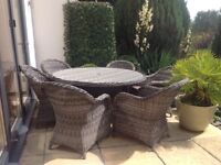 Large patio table & 6 chairs with cushions. Excellent condition house move forces sale.