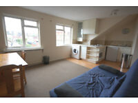 Offered large furnished double studio flat on the 2nd (top) floor of conversion.