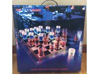 Glass chess board with shot glass chess pieces-display item (perfect for home bar) or drinking game!