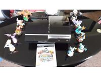 PS3 with selection of games and Skylander Figures.