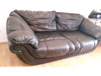 2 x 2 seater black leather sofas (will easily sit 3 persons)
