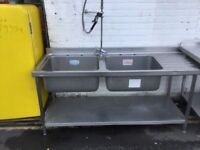 Stainless steel double sink with tap