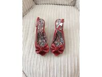 Red patent designer wedges in size 6