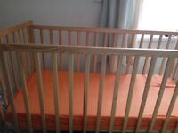 a baby cot with matress for 15 pounds