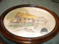 A WATER COLOUR OF BICKTON DORSET BY C N WOOD IN OVAL FRAME 19X14 INCHES