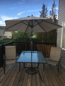 Patio table, 2 chairs, umbrella and stand