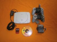 Playstation one with all leads 2 pads memory card and 1 game