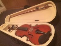 Violin. Excellent condition except for note stickers, barely used. Full size 4/4