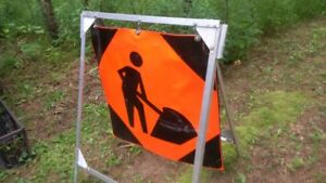 men at work construction safety sign