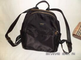 2 ladies backpacks, 1 leather, 1 leather material both in excellent condition