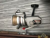 Daiwa 7000c spinning reel 12 ft beach caster 8ft boat rod