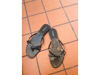 Ladies black flat front strap sandals