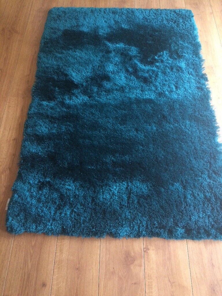 Teal rug and teal window ornamentin Larkhall, South LanarkshireGumtree - Teal tug and window ornament from a non smoking house both in immaculate condition