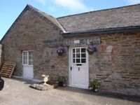 A beautiful one-bedroom furnished barn conversion set within an enclosed courtyard with parking