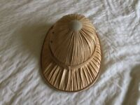 Straw safari helmet, also known as sun helmet, topee, sola topee or topi