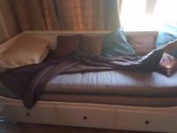 Ikea Daybed with 2 mattresses so opens up to double bed. very comfortable. three drawers underneath