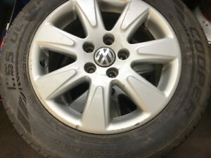 Four factory VW rims with tires