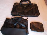 Holdall / sports or travel 3 bag set, plus an extra one free. all new unused.