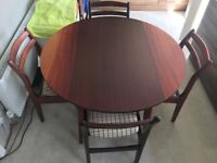 Dining table with chairs (round with foldable sides; sits 2-4)