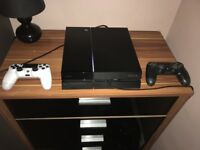 PlayStation 4 execellent condition with 4 games On profile and 2 controllers and charging lead