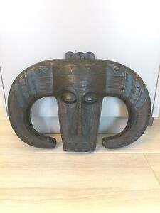 Carved wooden tribal mask wall hanging