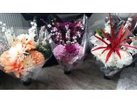 Artifial flower arrangements (grave)