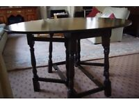 Gate-leg, folding leaf, oval table and four matching chairs. Very good condition.