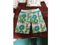 Women's blue & lime floral Animal board shorts size 14