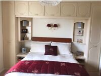 Two fitted wardrobes and overbed storage